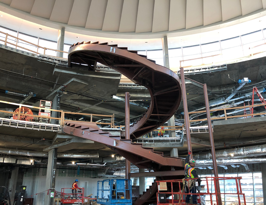 steel spiral stringers for custom spiral staircase at new American Airlines Headquarters in Fort Worth, Texas