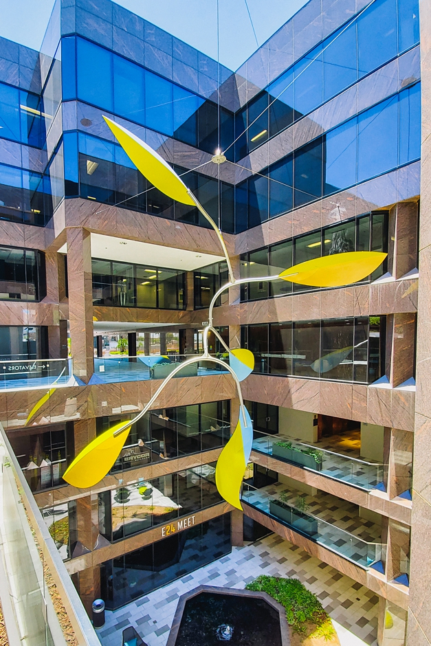 Curved Stainless Steel Artwork at Camelback Commons